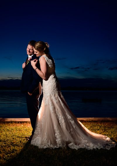 Bride hugging Groom from the back by the water, Fort Walton Beach, Fort Walton Yacht Club, Florida Wedding, Lazzat Photography
