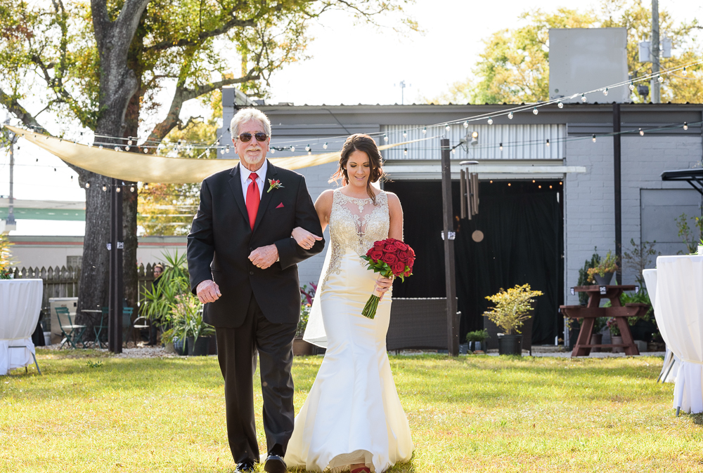 Close up of Dad walking Bride down the aisle, outdoor wedding ceremony at the Rails on Wright Street, Classic Red and White Wedding, Lazzat Photography, wedding photography, wedding photographer