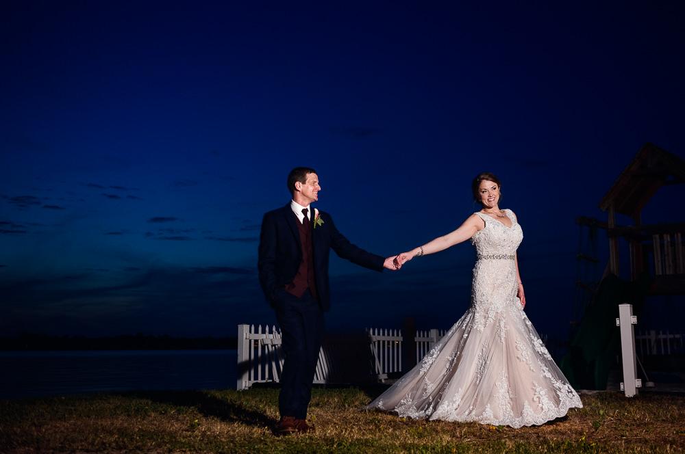 Bride leading Groom along the water, Fort Walton Beach, Fort Walton Yacht Club, Florida Wedding, Lazzat Photography