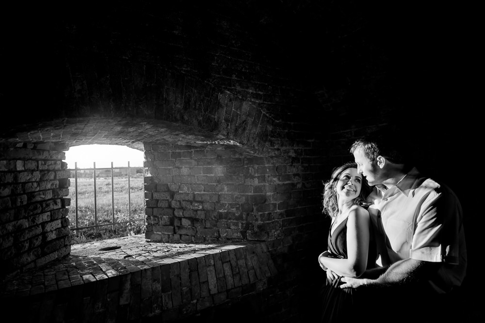 Couple smiling at each other, black and white, Fun Engagement Session at Eden Garden and Fort Pickens, Lazzat Photography, engagement photos