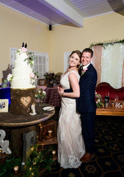 Bride and Groom by their wedding cake, Fort Walton Beach, Fort Walton Yacht Club, Florida Wedding, Lazzat Photography