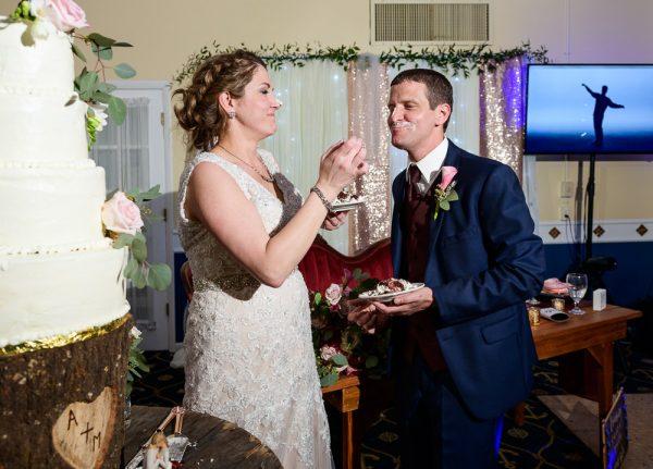 Bride feeding Groom their wedding cake, Fort Walton Beach, Fort Walton Yacht Club, Florida Wedding, Lazzat Photography