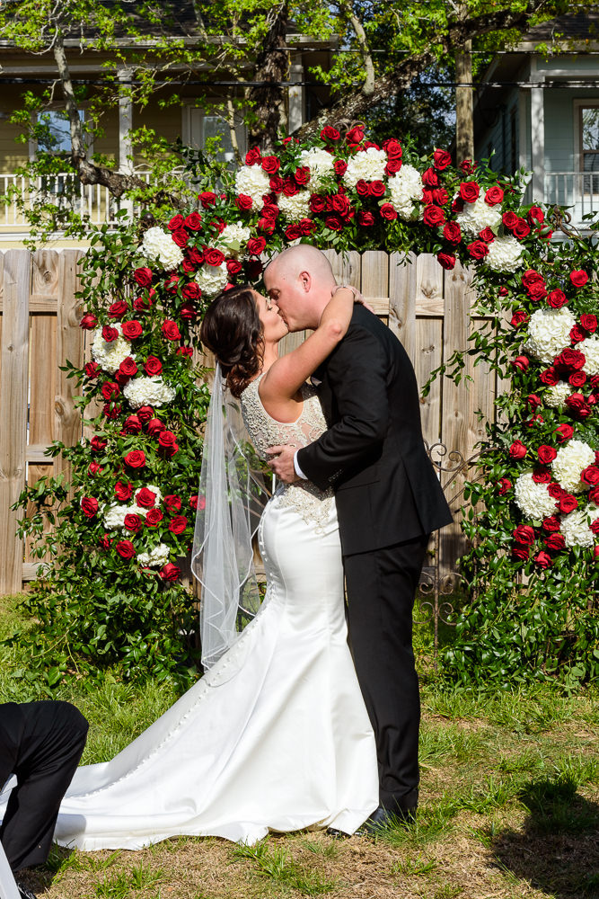 Bride and Groom's first kiss, outdoor wedding ceremony at the Rails on Wright Street, Classic Red and White Wedding, Lazzat Photography, wedding photography, wedding photographer