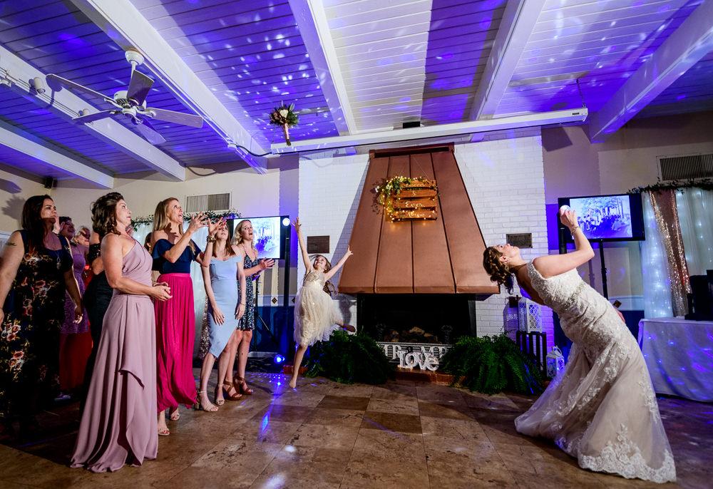 Bride tossing her bouquet, Fort Walton Beach, Fort Walton Yacht Club, Florida Wedding, Lazzat Photography