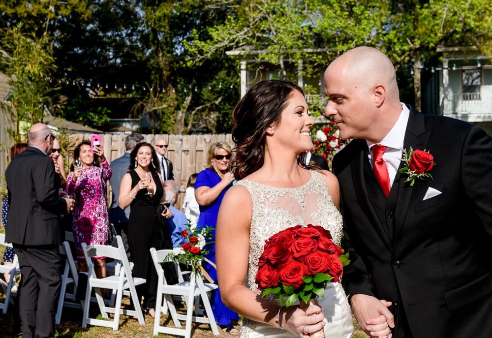 Bride and Groom looking at each other at the end of the aisle, outdoor wedding ceremony at the Rails on Wright Street, Classic Red and White Wedding, Lazzat Photography, wedding photography, wedding photographer