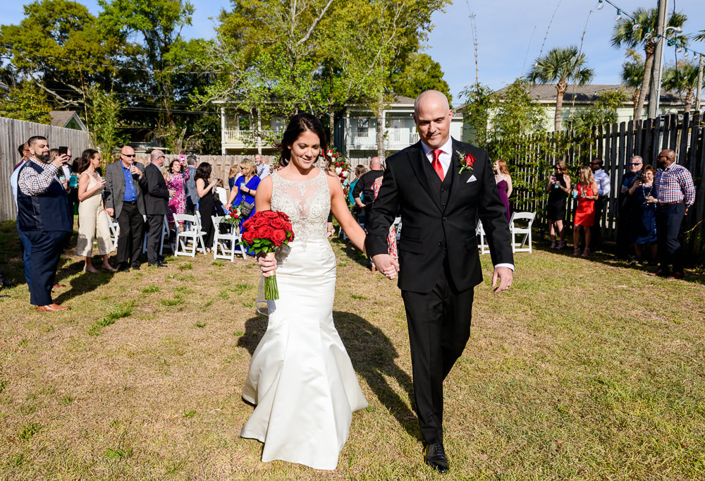 Bride and Groom walking down the aisle, outdoor wedding ceremony at the Rails on Wright Street, Classic Red and White Wedding, Lazzat Photography, wedding photography, wedding photographer