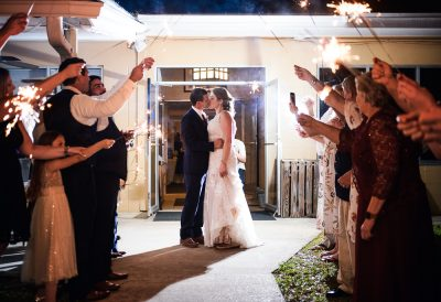Bride and Groom kissing before their sparkler exit, Fort Walton Beach, Fort Walton Yacht Club, Florida Wedding, Lazzat Photography