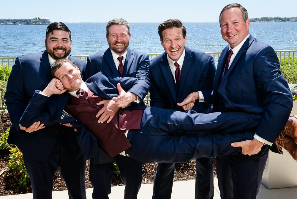 Groomsmen holding Groom by the water, Groom photos, Rustic Waterfront Wedding, Fort Walton Beach, Fort Walton Yacht Club, Florida Wedding, Lazzat Photography