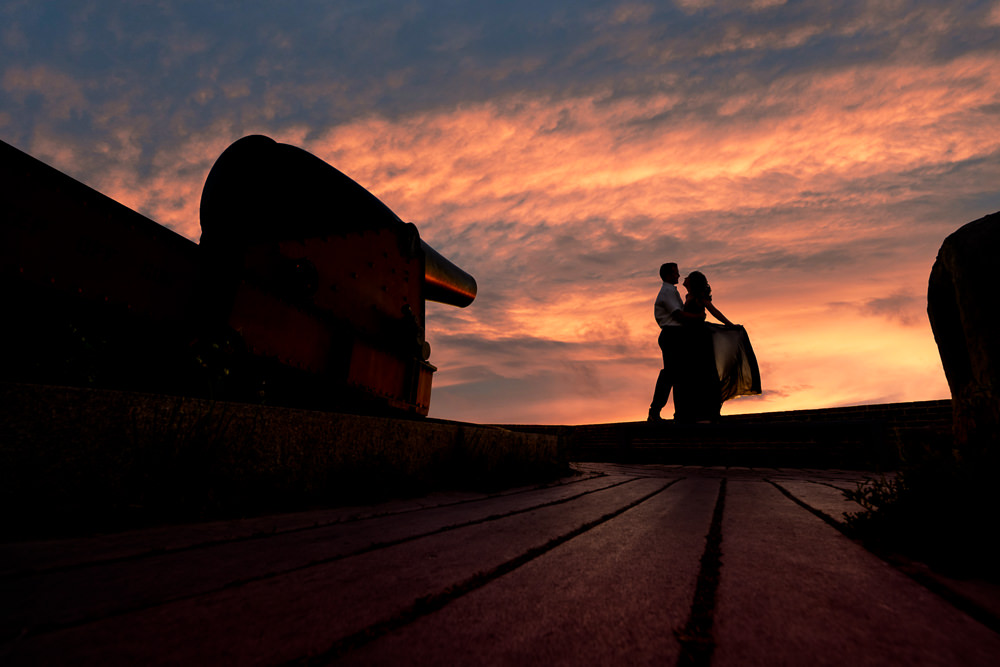 Silhouette of couple by the cannon at sunset, Fun Engagement Session at Eden Garden and Fort Pickens, Lazzat Photography, engagement photos