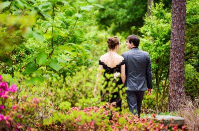 Taylor and Bob walking away, Beautiful Mobile Botanical Gardens Engagement Session, Lazzat Photography