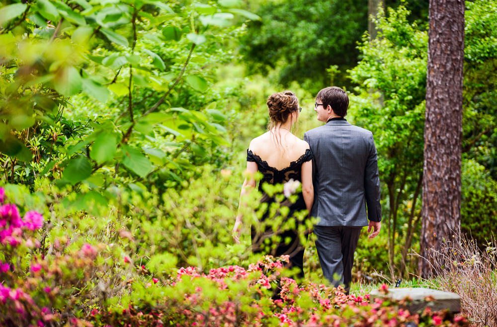 Taylor and Bob walking away, Beautiful Mobile Botanical Gardens Engagement Session, Lazzat Photography