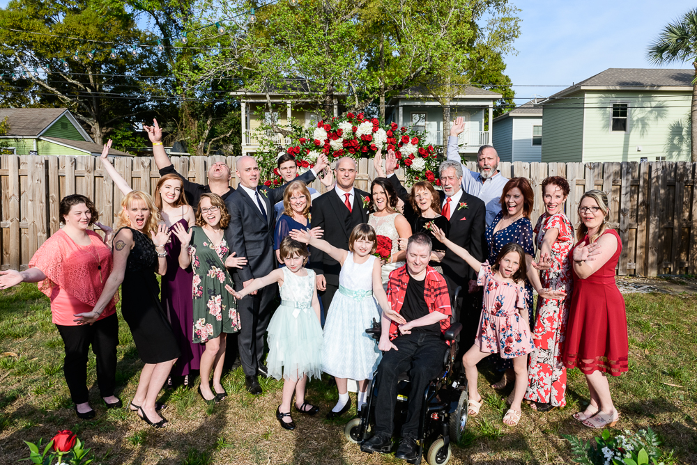 Bride and Groom with their whole family cheering at the Rails on Wright Street, Classic Red and White Wedding, Lazzat Photography, wedding photography, wedding photographer