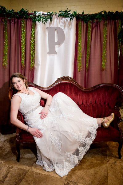 Bride on their red velvet loveseat, Fort Walton Beach, Fort Walton Yacht Club, Florida Wedding, Lazzat Photography