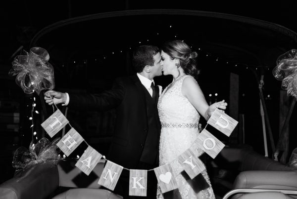 """Bride and Groom kissing on their exit boat with """"Thank You"""" sign, Fort Walton Beach, Fort Walton Yacht Club, Florida Wedding, Lazzat Photography"""