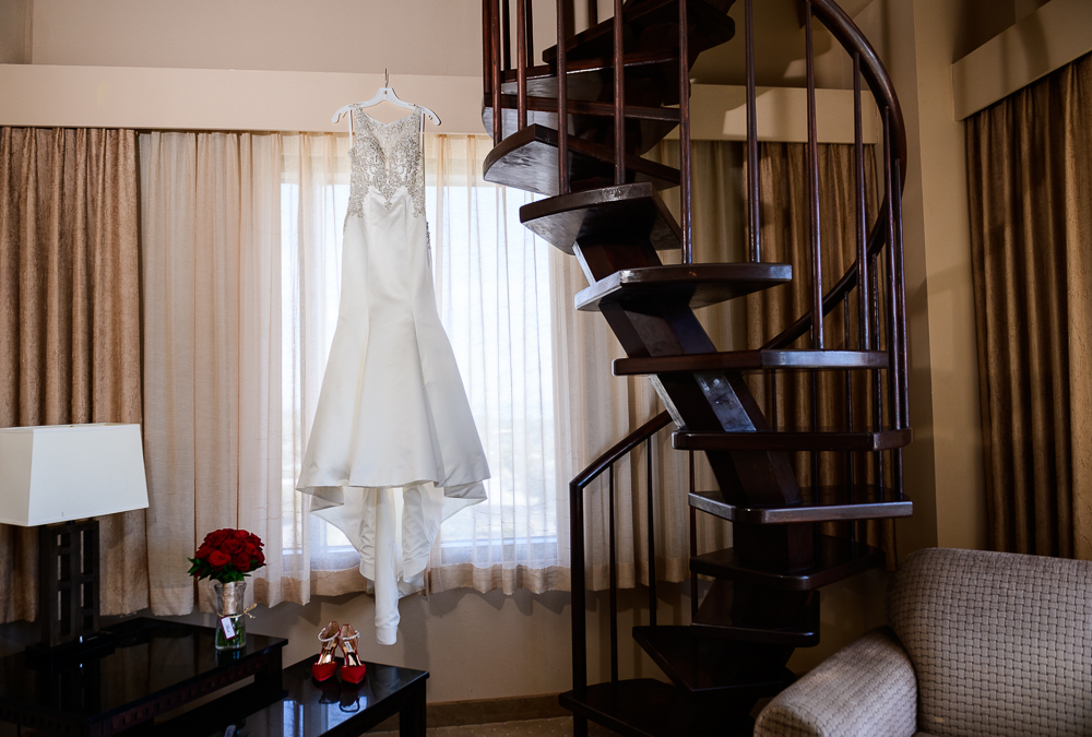 Bride's dress hanging at the Pensacola Grand Hotel, bridal gown, wedding gown, Classic Red and White Wedding, Lazzat Photography, wedding photography, wedding photographer
