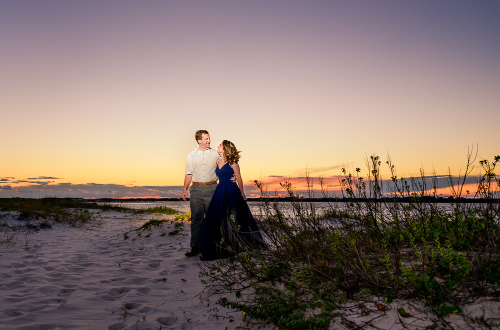 Couple walking on the beach at sunset, Fun Engagement Session at Eden Garden and Fort Pickens, Lazzat Photography, engagement photos