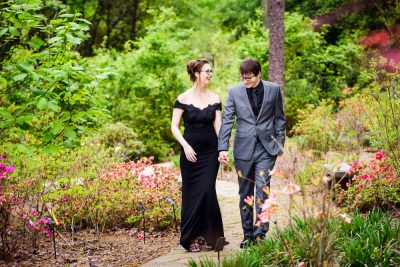 Taylor and Bob walking and laughing, Beautiful Mobile Botanical Gardens Engagement Session, Lazzat Photography