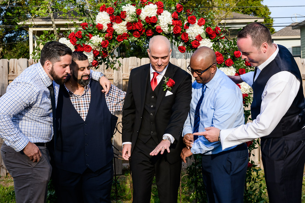 Groom's friends looking at his wedding ring at the Rails on Wright Street, Classic Red and White Wedding, Lazzat Photography, wedding photography, wedding photographer