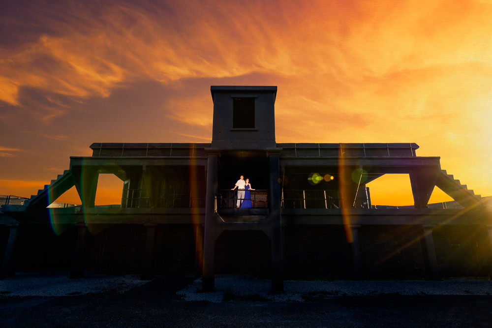 Couple standing on a balcony at sunset, black and white, Fun Engagement Session at Eden Garden and Fort Pickens, Lazzat Photography, engagement photos