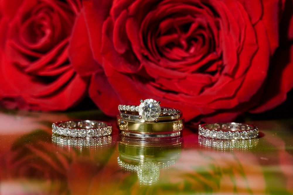 Bride and Groom's wedding rings in front of red roses at the Rails on Wright Street, Classic Red and White Wedding, Lazzat Photography, wedding photography, wedding photographer