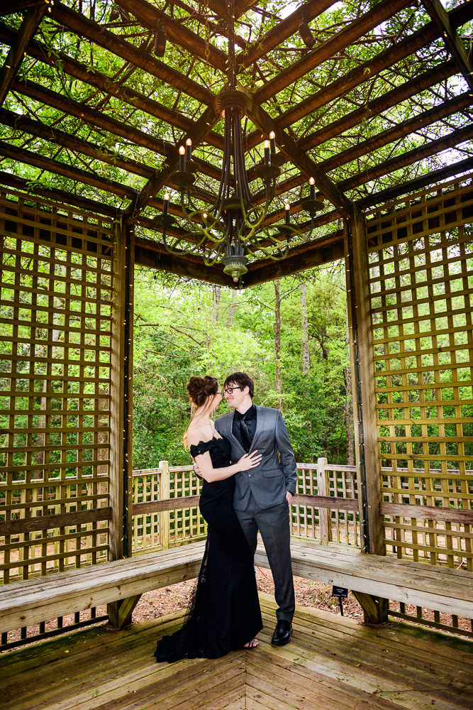 Couple under a wooden gazebo, Beautiful Mobile Botanical Gardens Engagement Session, Lazzat Photography