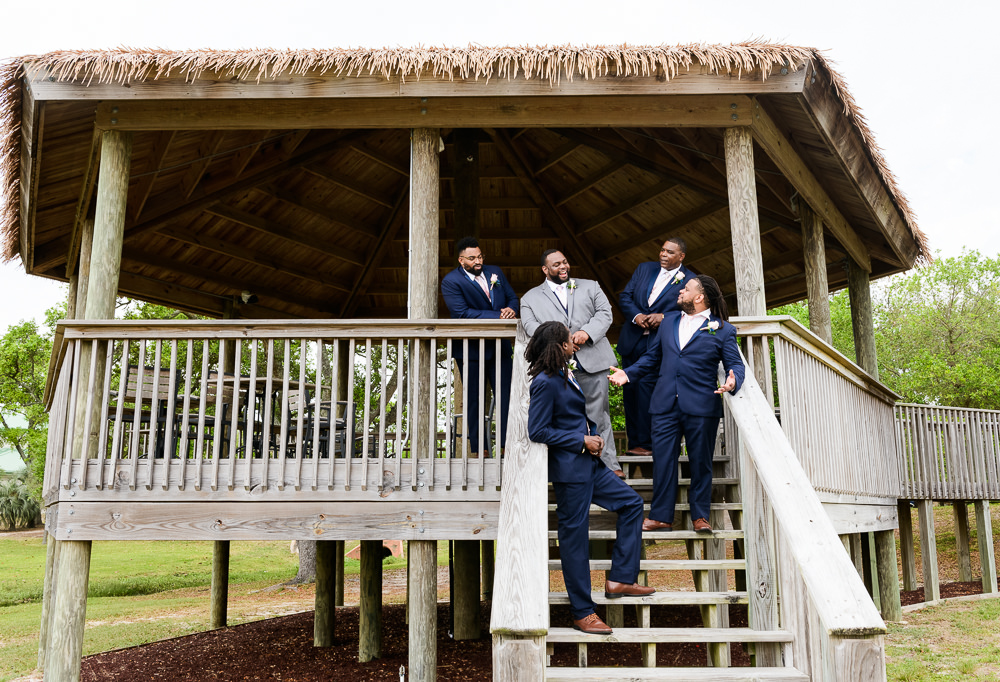 Groom and Groomsmen on the gazebo steps, Blue and Pink Wedding, The Soundside Club, Elegant Ballroom Wedding, Lazzat Photography, Florida Wedding Photography