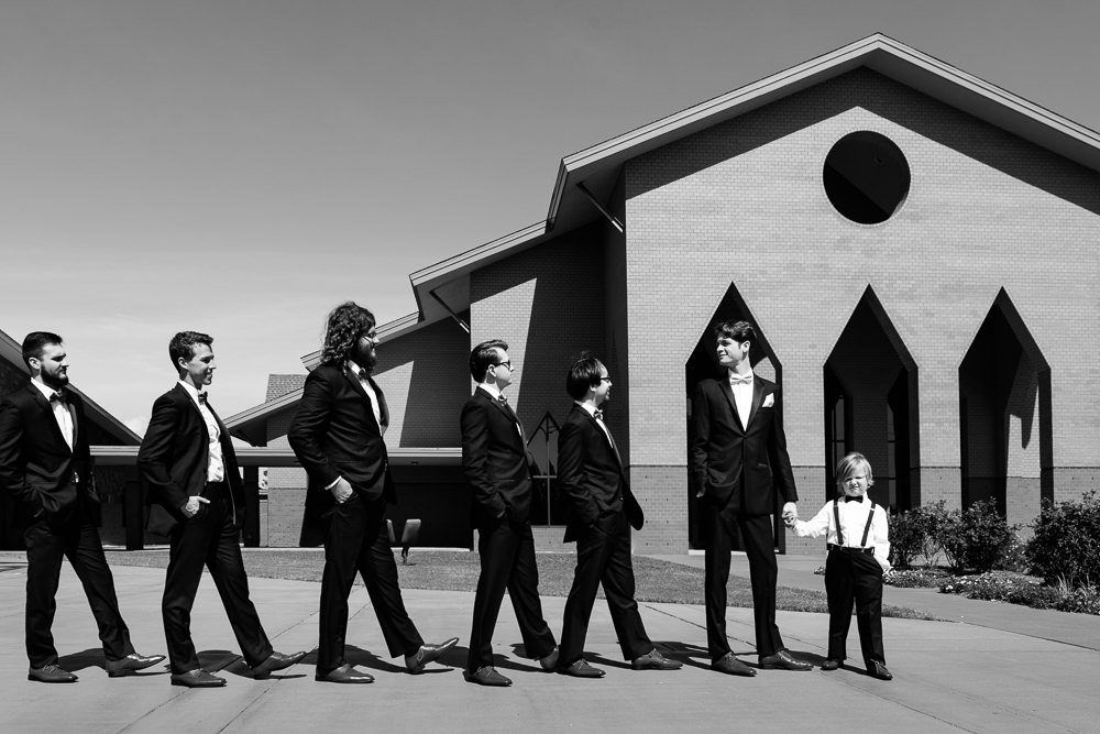 Groom and his groomsmen walking to the church, black and white, Romantic Catholic Wedding, Pensacola Florida Wedding Photographer, Lazzat Photography