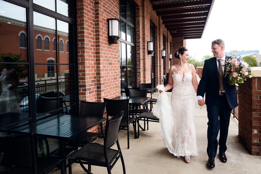 Bride and Groom walking holding hands after their first look, Classic Pensacola Wedding, Lazzat Photography, Florida Wedding Photographer