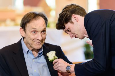 Groom putting boutonniere on his dad, Romantic Catholic Wedding, Pensacola Florida Wedding Photographer, Lazzat Photography