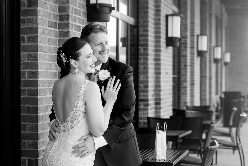 Bride and Groom smiling into the distance after their first look, black and white, Classic Pensacola Wedding, Lazzat Photography, Florida Wedding Photographer