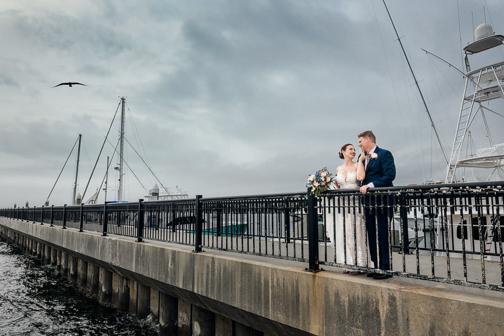 Bride and Groom posing on the pier, Classic Pensacola Wedding, Lazzat Photography, Florida Wedding Photographer