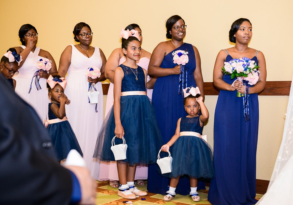 Bridesmaids and flower girls watching the Bride and Groom get married, Blue and Pink Wedding, The Soundside Club, Elegant Ballroom Wedding, Lazzat Photography, Florida Wedding Photography