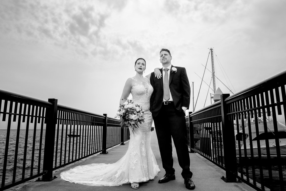 Bride and Groom posing on the pier, black and white, Classic Pensacola Wedding, Lazzat Photography, Florida Wedding Photographer