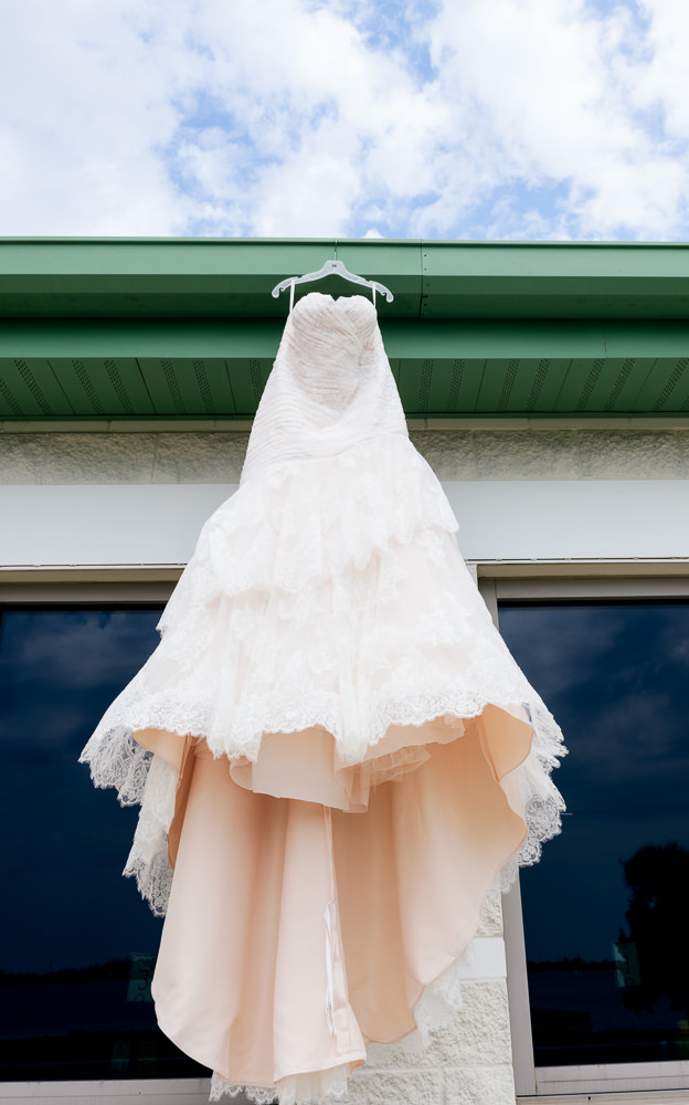 Bride's wedding dress hanging, The Soundside Club, Elegant Ballroom Wedding, Lazzat Photography, Florida Wedding Photography