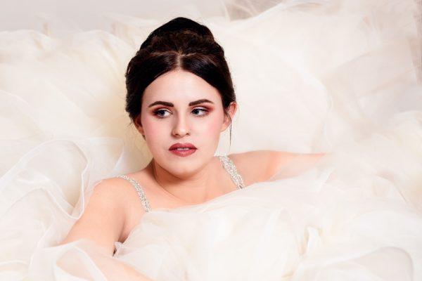 Close up of Bride getting into her ballgown, bridal portrait, Romantic Catholic Wedding, Pensacola Florida Wedding Photographer, Lazzat Photography