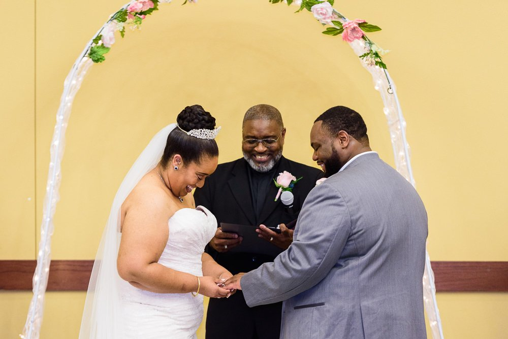 Bride and Groom exchanging rings, Blue and Pink Wedding, The Soundside Club, Elegant Ballroom Wedding, Lazzat Photography, Florida Wedding Photography