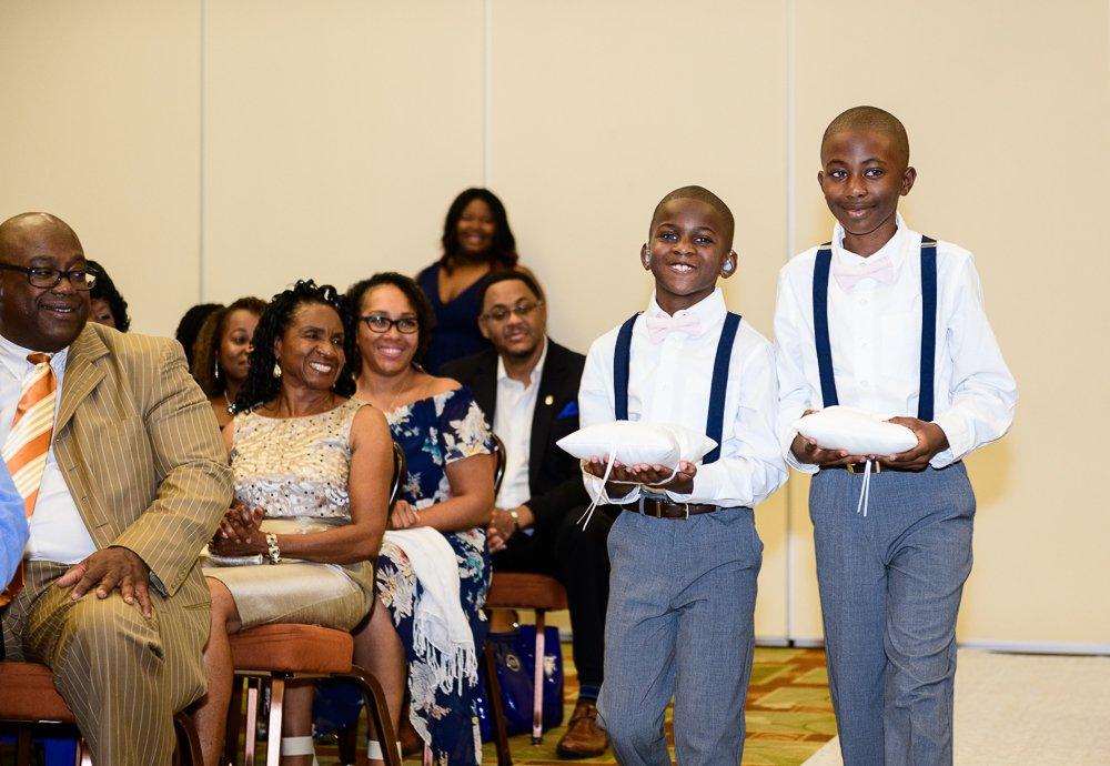 Ring bearers walking down the aisle, Blue and Pink Wedding, The Soundside Club, Elegant Ballroom Wedding, Lazzat Photography, Florida Wedding Photography