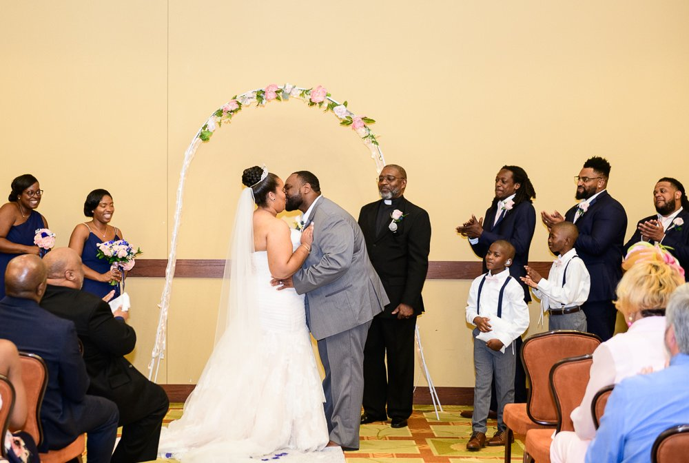 Bride and Groom's first kiss, Blue and Pink Wedding, The Soundside Club, Elegant Ballroom Wedding, Lazzat Photography, Florida Wedding Photography