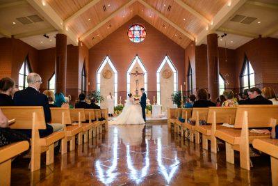 Bride and Groom holding hands during their ceremony, Romantic Catholic Wedding, Pensacola Florida Wedding Photographer, Lazzat Photography