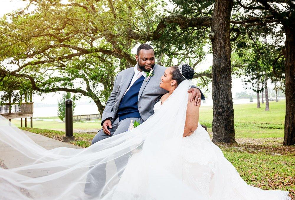 Bride and Groom sitting outside, epic veil, Blue and Pink Wedding, The Soundside Club, Elegant Ballroom Wedding, Lazzat Photography, Florida Wedding Photography