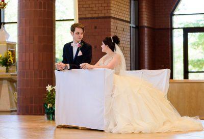 Bride and Groom kneeling during their wedding ceremony, Romantic Catholic Wedding, Pensacola Florida Wedding Photographer, Lazzat Photography