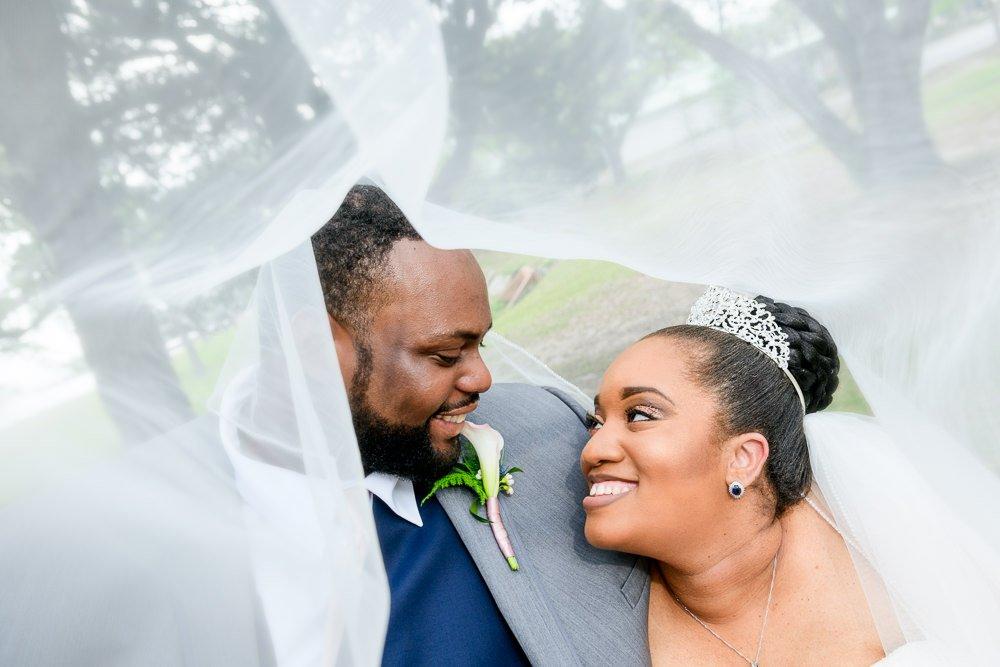 Bride and Groom under the veil, Blue and Pink Wedding, The Soundside Club, Elegant Ballroom Wedding, Lazzat Photography, Florida Wedding Photography