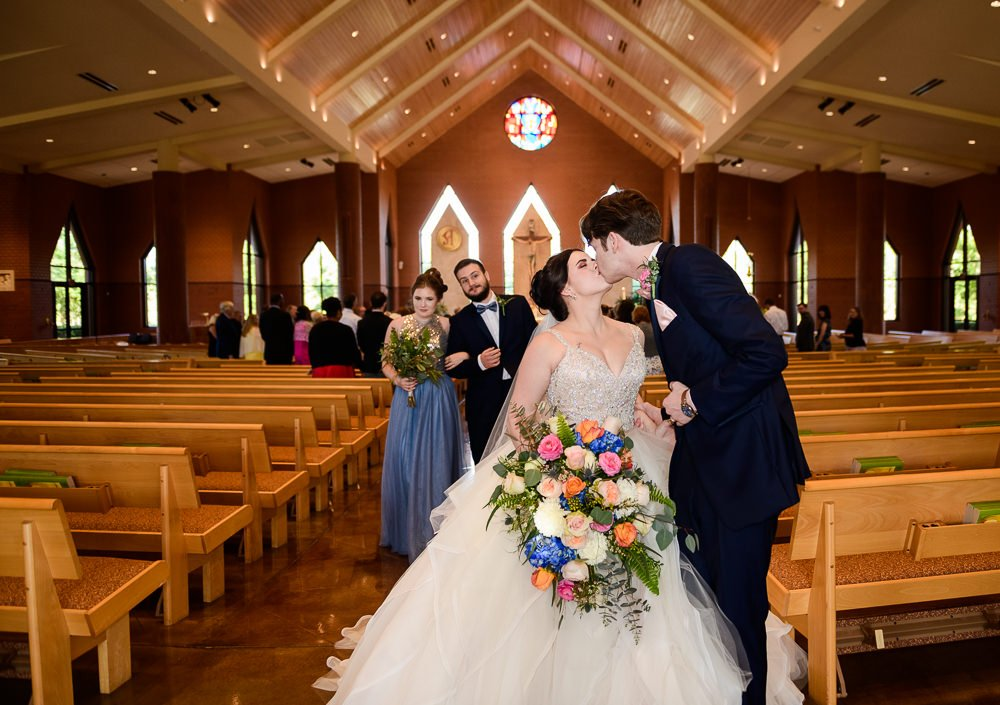 Bride and Groom kissing at the end of the aisle, Romantic Catholic Wedding, Pensacola Florida Wedding Photographer, Lazzat Photography