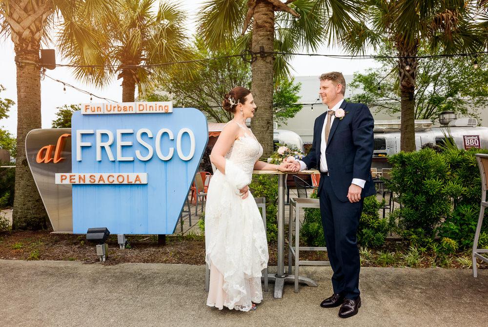 Bride and Groom at al Fresco downtown Pensacola, Classic Pensacola Wedding, Lazzat Photography, Florida Wedding Photographer