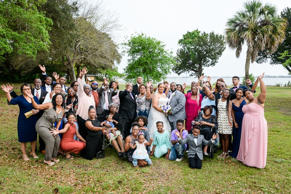 Bride and Groom with their whole family cheering, Blue and Pink Wedding, The Soundside Club, Elegant Ballroom Wedding, Lazzat Photography, Florida Wedding Photography