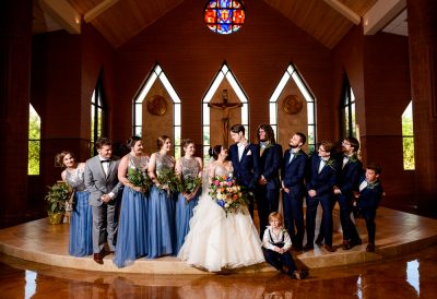 Bride and Groom looking at each other with their wedding party looking at them, Romantic Catholic Wedding, Pensacola Florida Wedding Photographer, Lazzat Photography