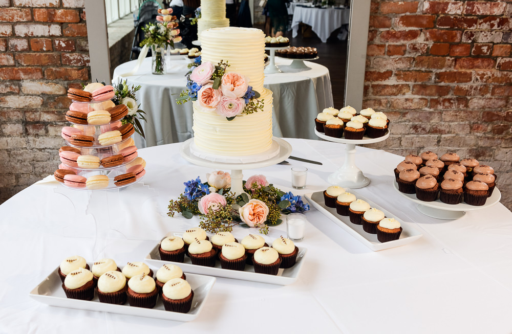 White wedding cake with pink and blue flowers and cupcakes, 5Eleven Palafox, Classic Pensacola Wedding, Lazzat Photography, Florida Wedding Photographer
