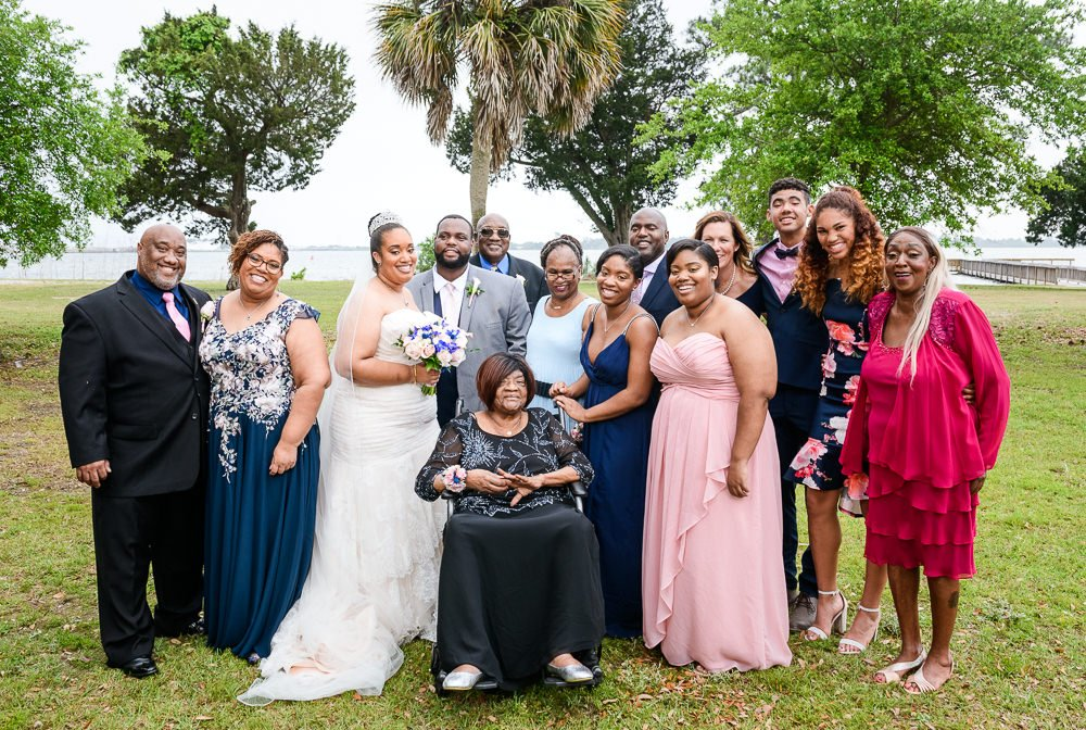 Bride and Groom with Bride's family, Blue and Pink Wedding, The Soundside Club, Elegant Ballroom Wedding, Lazzat Photography, Florida Wedding Photography