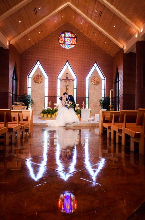 Groom dipping Bride in their church, Romantic Catholic Wedding, Pensacola Florida Wedding Photographer, Lazzat Photography