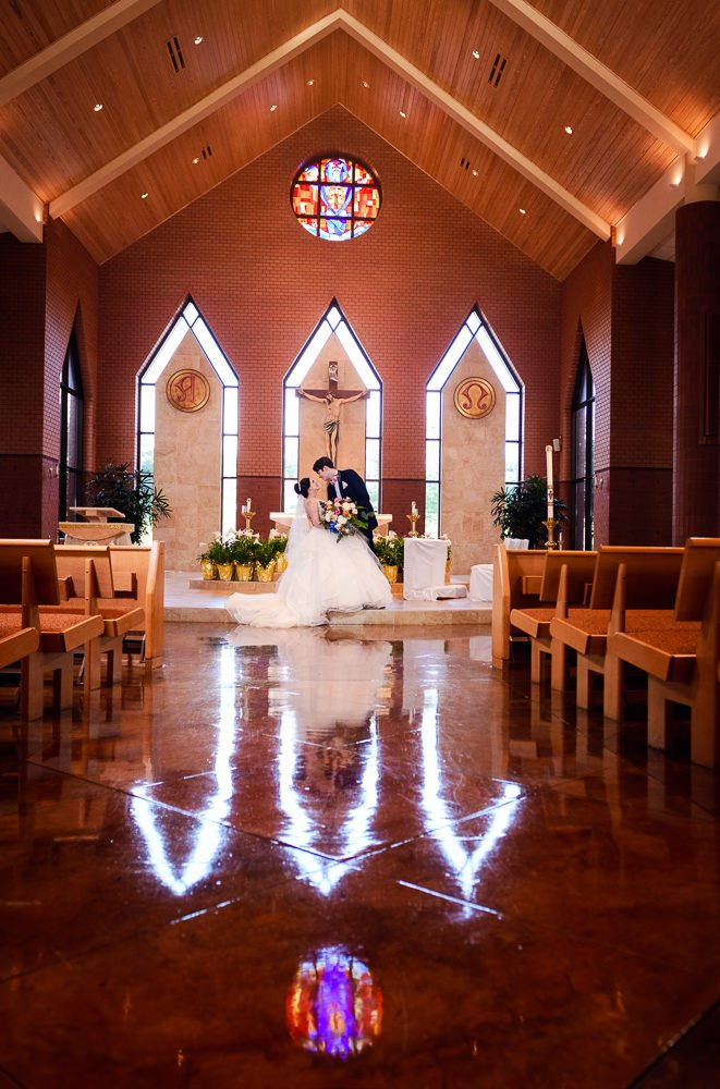 Groom dipping Bride in their church, Romantic Catholic Wedding, Pensacola Florida Wedding Photographer, Lazzat Photography